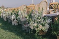 White floral arrangements and antique lanterns