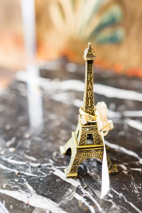 paris eiffel tower with ribbon and yellow gold wedding rings engagement ring men's band