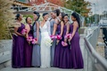 bride in berta wedding dress, bridesmaids in purple, bridesmaids in slate grey
