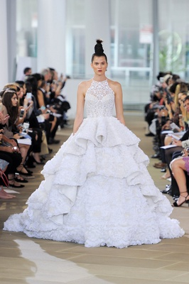 Cut in halter illusion neck ball gown with intricate ruffled tiered skirt and two tiered cathedral t