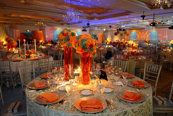 Travel themed teal papaya wedding in st louis missouri wedding reception table with colorful centerpieces in tall vases junglespirit Images