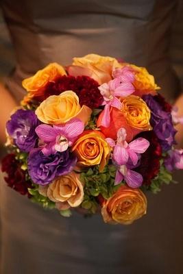 Purple, pink, orange, and red bridesmaid flower bouquet