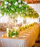 long table tall foliage arrangements shiny linen wedding hotel del coronado sequins ballroom