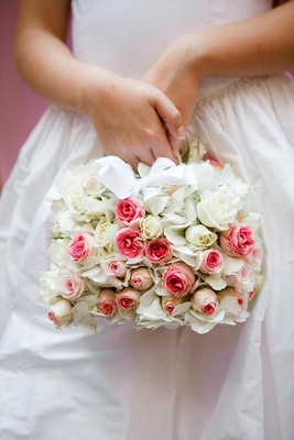 Flower girl basket covered in pink and white roses
