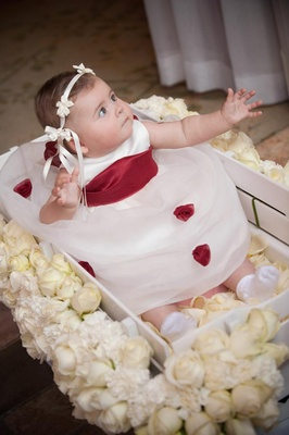 Baby flower girl in rose covered box