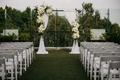 rooftop wedding, simple arch with white drapery and ivory flowers