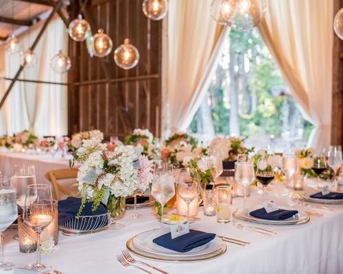 wedding reception barn venue drapery orb pendants navy napkin u-shape table formation wine