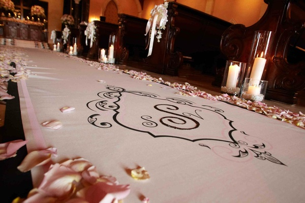 Petal-lined aisle with couple's wedding monogram