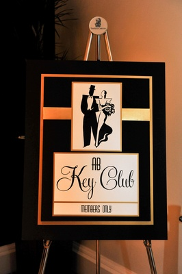 The Great Gatsby-themed black and gold sign