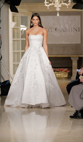 Oleg Cassini Fall 2018 bridal collection strapless satin ball gown with pockets and appliques