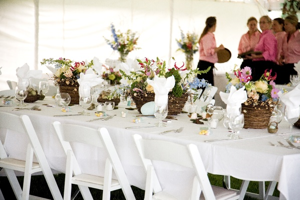 Caterers in pink and long table with bird influences
