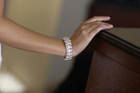 bride wearing diamond cuff bracelet