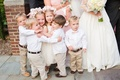 Ring bearers in khaki pants and white shirts and flower girls
