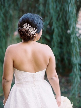 White strapless ball gown with buttons and updo flower headpiece