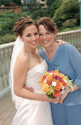 Bride and mother in blue
