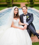 Bride in Zuhair Murad wedding dress ball gown from Kleinfeld with groom in bow tie at Grand Del Mar