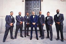 wedding portraits groom and groomsmen navy suits black bow ties shoes in front of vibiana