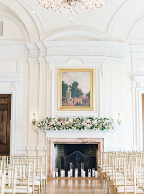 wedding ceremony gold chairs altar fireplace fresh flowers sconces artwork oheka castle wedding