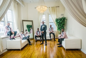 groom in tuxedo, groomsmen with dusty pink tuxedo jackets