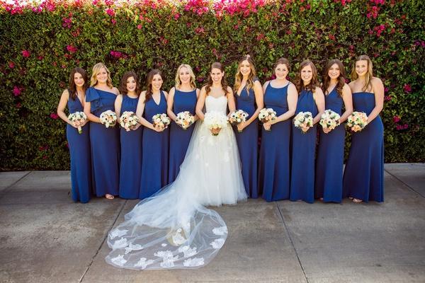 bride in strapless monique lhuillier wedding dress bridesmaids in royal blue navy gowns necklines