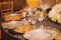 Black sequin linens and gold-beaded chargers