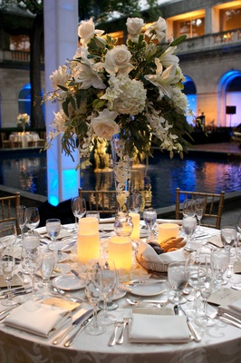 Fountain-side table with romantic centerpiece