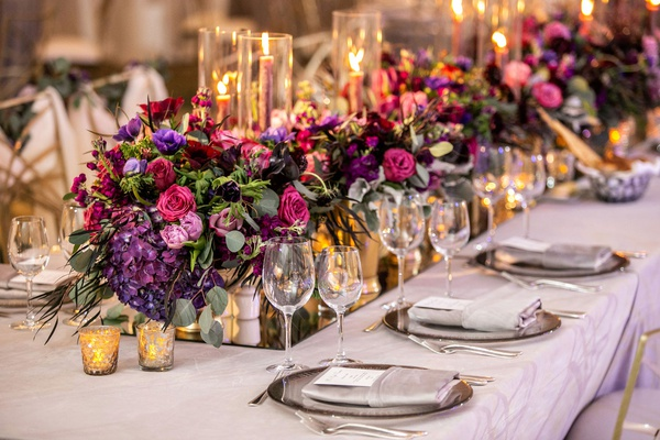 wedding reception mirror runner pink purple flowers greenery candle votives taper candles
