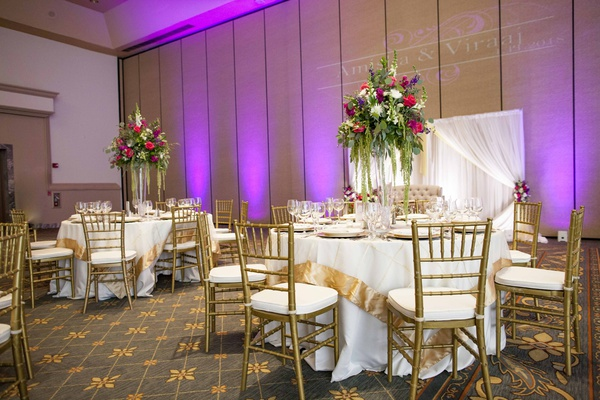 south asian wedding inspiration, ivory linens with thick gold border, gold chiavari chairs