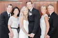 Bride in Hayley Paige dress, groom, mothers in white lace dresses