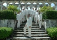 Men in khaki on Cloisters 14th century steps