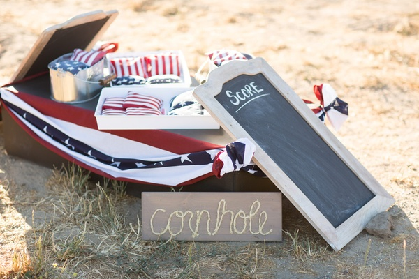 Cornhole game supplies with American flag patterns.