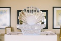 Wedding reception in a venue by the sea with a seashell and pearl ice sculpture