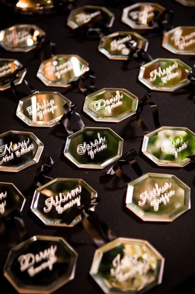 glass octagon ornaments with guests names painted on