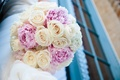 Bride's bouquet of vanilla roses and lilac peonies
