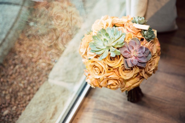 bridesmaid bouquet with peach flowers, green succulent, purple succulent