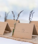 Natural table cards with lavender sprigs fastened with clothespin