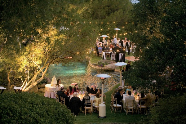 Poolside cake table and dance floor at night