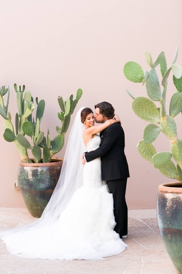 Adrianna Costa and Scott Gorelick in between prickly pear cactus