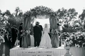 Black and white photo of couple under chuppah
