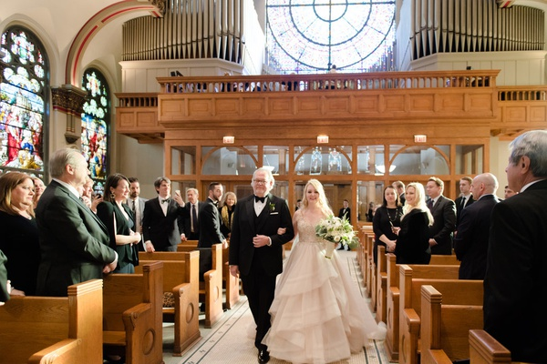 bride in martina liana layered blush ballgown, walked down aisle with father in catholic church