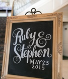 Wedding reception chalboard sign in decorative wood frame, bride & groom's names, wedding date
