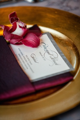 Brock Osweiler and Erin Costales wedding menu in burgundy napkin
