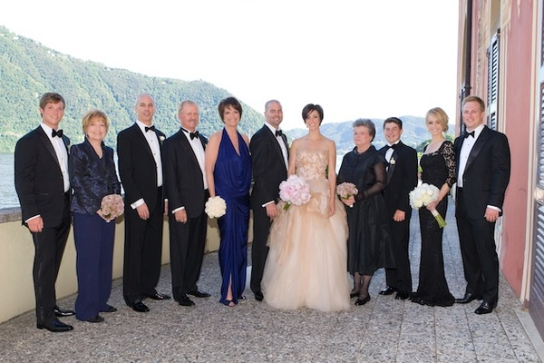 Bride and groom with family in formal attire