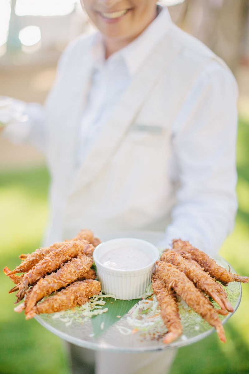 Clear platter of coconut shrimp with dipping sauce