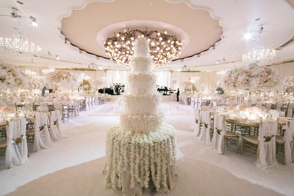 five tier, six foot tall wedding cake completely covered in sugar flowers