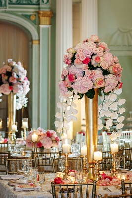 Gold vase with pink roses, hydrangeas, and white orchids