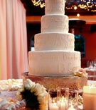 Wedding cake with icing of bride and groom's memories