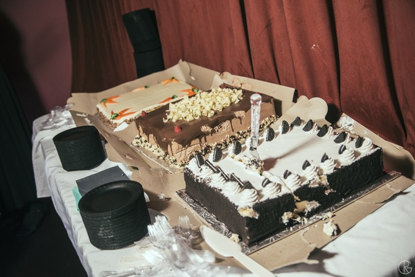 Carrot cake, chocolate cake, and oreo cake at wedding
