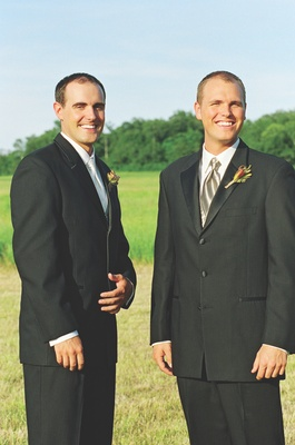 Men wearing pinstripe suits and boutonnieres