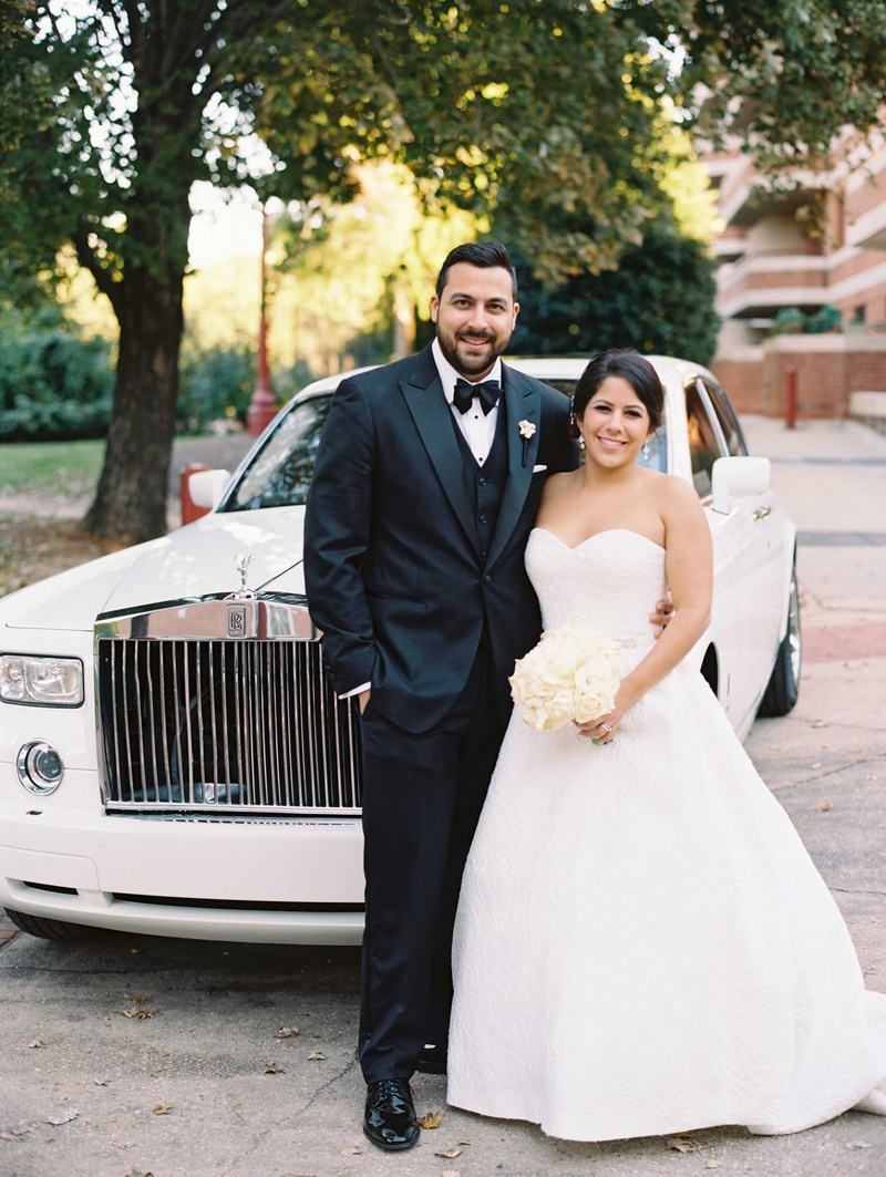 e9f95ed8f ... Groom in tuxedo and bow tie bride in strapless ball gown in front of  Rolls Royce ...